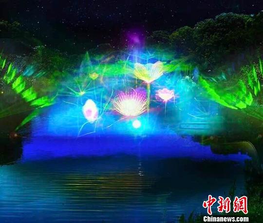 图为,武汉东湖萤火虫主题公园光影技术营造萤火虫氛围 李中 摄
