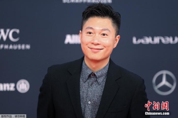 资料图:中国前体操运动员李小鹏在摩纳哥举行的2018年劳伦斯世界体育奖红毯仪式上。
