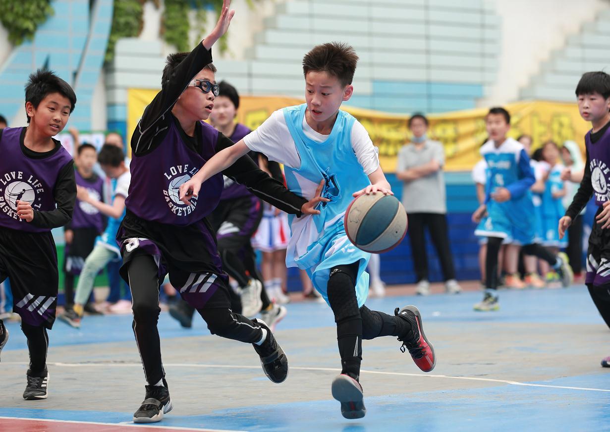 资料图:北京市和平里一小篮球比赛。图片来源:和平里一小。