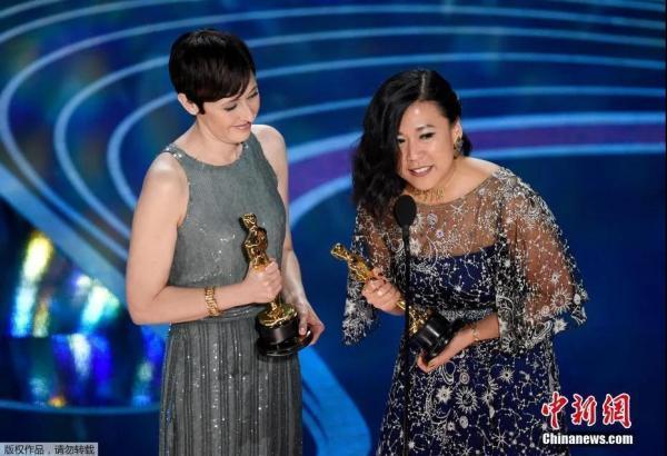 资料图:第91届奥斯卡颁奖典礼现场,执导《包宝宝》的华裔导演石之予上台领取奥斯卡最佳动画短片奖。