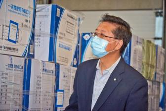 Man behind the masks: Doctor helps procure gear