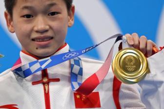 Diving darling Quan wins nation's heart